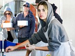 Defeating the object: Ashley Benson enjoys cake baking class after workout session with good friend Izak Rappaport