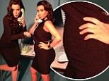 Bump ahead! Khloe and Kim Kardashian pose up together for a playful photo shoot
