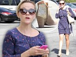 A boot-iful sight! Reese Witherspoon glams up outfit with sparkling gold footwear