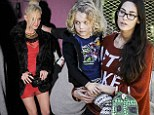 Single girl Ashlee Simpson hits town in a little red dress as her ex-husband's girlfriend Meagan looks after her son Bronx
