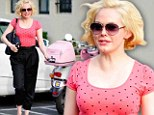 Vroom with a view! Rose McGowan is pretty in pink as she shows off matching scooter