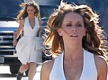 Stunt woman! Jennifer Love Hewitt is forced to make a run for it in a low cut halter neck frock on set of The Client List