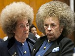 Al Pacino dons a huge wig as he's transformed into Phil Spector in new stills from controversial TV movie