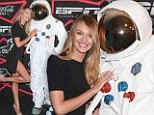 That is one lucky spaceman: Candice Swanepoel wears a sexy thigh high split to go on a date with an astronaut