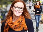 There goes a fiery redhead! Marcia Cross livens up casual outfit with orange print scarf... while enjoying rare time alone