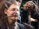 Guess who! Katie Holmes masters the art of disguise... on a very blustery outing in the Big Apple