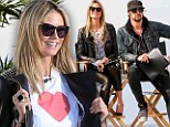 We 'heart' you too! Heidi Klum shows off a heart shirt -- and possible show spoiler -- as she films Germany's Next Topmodel on Venice Beach