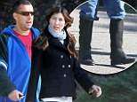 Scared of snakes Adam? Sandler uses chaps to stave off a rattlesnake attack on hike... while wife sticks to her jeans