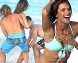Well, that is what it's made for! Alessandra Ambrosio is chucked in the ocean after epic Victoria's Secret bikini shoot
