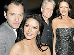 Her leading men! Catherine Zeta-Jones lives it up with husband Michael Douglas and co-star Jude Law at Side Effects party