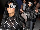 That's an interesting outfit! Lil Kim looks as outrageous as ever in sheer top and leather trousers