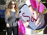 Don't forget my name! Sofia Vergara makes sure fans spot her with an eye-catching 'SV' mobile phone case