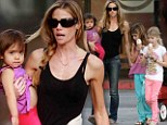 Zero body fat: Denise Richards displays bony, veiny arms while getting ice-cream with her kids