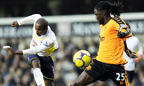 Mario Melchiot is little more than a spectator as Jermain Defoe scores in the 9-1 win for Spurs