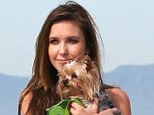 Lady and her owner: Audrina picks up her tiny pup on the walk, perhaps as Lady was a little tired