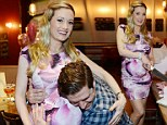 That's my girl! Holly Madison's growing bump is embraced by her boyfriend at unisex baby shower