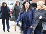 Touchy feely Kim Kardashian holds hands with both her lawyer and a friend as pregnant star endures stressful day of divorce proceedings