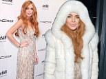 It's not THAT cold Lindsay! Lohan arrives at charity gala in hooded fur jacket... before revealing her glittering gold gown beneath