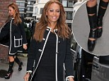 When Scary Spice tried to be Posh: Mel B ruins her chic ensemble with a pair of slashed knee high leather boots