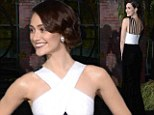 What a beautiful creature! Emmy Rossum stands above the crowd in sexy black and white gown at the premiere of Beautiful Creatures