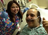 Bouncing back! Porn star Ron Jeremy gives a thumb's up from his hospital bed at Cedars-Sinai in LA on Wednesday after suffering an aneurysm near his heart last week