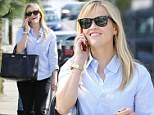 Those gym sessions are paying off! Reese Witherspoon cuts a svelte figure in jeans and blue shirt on errand run