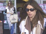 Hiding out! Sofia Vergara drapes her curves in flowing tan and mocha scarf to grocery shop at Bristol Farms