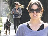 Working up a sweat! Nikki Reed hits the sidewalk running... with her big furry fella in Los Angeles