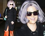 Fashionista Kelly Osbourne stopped by the Today show wearing a black jacket, bright salmon colored pants and a light green Chanel bag