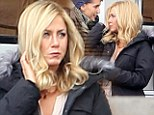 Taking some getting used to? Jennifer Aniston struggles to not touch her amazing platinum wig on the set of her new movie