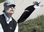 Talk about bad form! Bill Murray collapses in the sand after playing woeful shot at Pebble Beach pro-am golf tournament