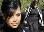 Showing no signs of slowing down! 'Stressed' Kim Kardashian displays her tiny baby bump in tight black dress as she heads to social media conference