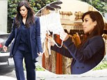 You might need a bigger size! Pregnant Kim Kardashian shops for sexy lingerie as she puts her own spin on maternity wear wearing a navy pantsuit