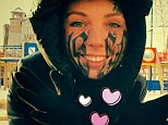 Disfigured: The girl - identified only as Lesya allowed her new boyfriend Rouslan Toumaniantz to tattoo his name on her face just 24 hours after they met