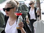 Amanda Seyfried carries large garment bags in Los Angeles on Thursday