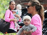 He's getting so big! A make-up free Molly Sims carries son Brooks in her arms as she runs errands