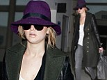 Shrinking violet! Jennifer Lawrence goes incognito in a purple hat and sunglasses as she jets to London for the Baftas