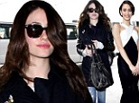 She's still a Beautiful Creature! Emmy Rossum slips into casual jeans and navy coat after glamorous turn at film premiere