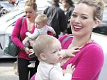 Hilary Duff has her hands full as she carries her baby boy Luca in her arms on her way to have lunch