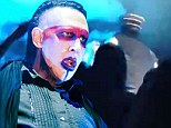 Marilyn Manson is helped off stage after he collapses during a performance of his hit song Beautiful People