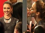 Jessica Alba sat in a celebrity kissing booth on Hollywood Boulevard in Los Angeles on Tuesday as pedestrians lined up to get their chance