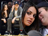 Love at the Lakers: Ashton Kutcher and Mila Kunis cuddle up courtside at basketball match