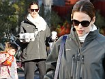 Mommy's little helper: Jennifer Garner gets a spot of help from Seraphina on coffee run