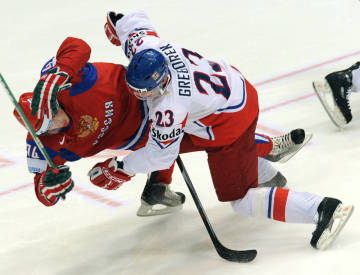 Russia's Alexei Emelin, left, and Czech Republic's Petr Gregorek collide during the IIHF world championship final in Cologne on Sunday.