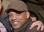 Scandal: Will Smith, pictured with son Trey on Tuesday night, is one of Hollywood's most squeaky clean superstars, but it has now been revealed that his brother-in-law Dee Lawrence Downs has been arrested on drugs charges