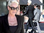 He must feel secure in himself! Brigitte Nielson, 49, towers over husband Mattia Dessi, 33, as they take sunshine stroll