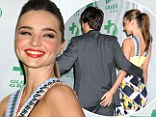 That's cheeky! Miranda Kerr gives her husband Orlando Bloom's behind a playful squeeze at pre-Oscars party
