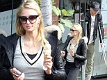 Talk about shop till you drop! Paris Hilton hits the stores while boyfriend River struggles to keep up on crutches