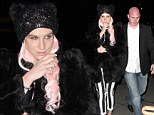 Meow: A pink haired Ke$ha turns herself into cat-sha donning feline ears in New York