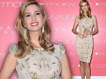 Scent of a woman! Blonde bombshell Ivanka Trump accentuates her stunning curves in an embellished figure-hugging dress for perfume launch